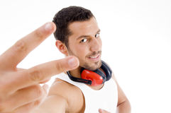 Male showing victory sign Royalty Free Stock Photos