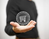 Male showing virtual shopping cart on palm, shopping concept Stock Photography