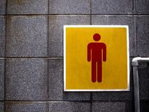 Male sign at a public toilet Stock Image