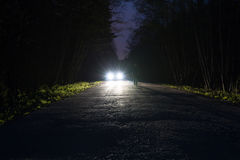 Free Male Silhouette At The Edge Of A Dark Mountain Road Through The Forest In The Night. Man Standing On The Road Against Stock Photo - 99049340