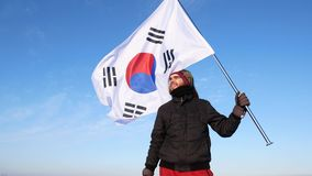Male silhouette figure waving South Korea flag
