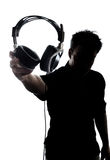 Male in silhouette showing headphones Stock Photos