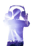 Male in silhouette showing headphones Royalty Free Stock Photo