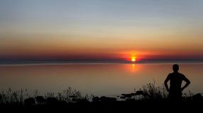 Male silhouette at sunset. Beautiful sunset Stock Image