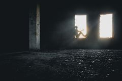 Male silhouette in window. Lit by dramatic sunlight Royalty Free Stock Photos