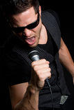 Male Singer. Handsome young male karaoke singer Royalty Free Stock Photo