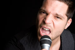 Male Singer. Male karaoke singer with microphone Royalty Free Stock Photography
