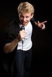 Male Singer. Singing karaoke music Stock Images
