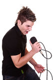 Male singer. Attractive male singer with microphone isolated on white Stock Image
