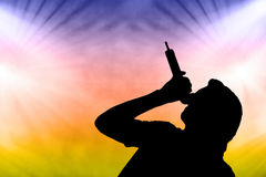 Male singer against colourful concert lights Stock Image