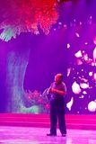Male singer huijianxin sing on ultra violet stage, srgb image