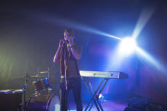 Male singer performing on illuminated stage in nightclub Royalty Free Stock Photography