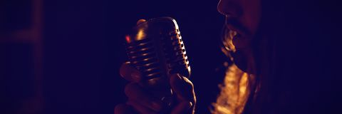 Male singer performing in nightclub. Close up of male singer performing in nightclub Royalty Free Stock Photo