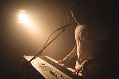 Male singer playing piano in nightclub Royalty Free Stock Photo