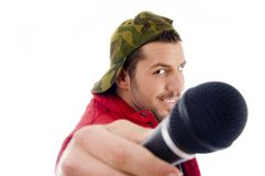 Male singer showing microphone. On an isolated white background Stock Image