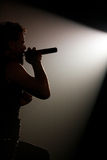 Male singer silhouette heavy metal concert. Concert photo of male singer holding microphone Royalty Free Stock Images