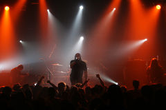 Male singer silhouette heavy metal concert. Male singer silhouette at rock, heavy metal concert with stage lights Stock Photos