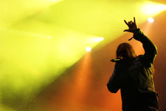 Male singer silhouette heavy metal concert. With stage lights Royalty Free Stock Photo