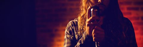 Male singer singing in nightclub. Close up of male singer singing in nightclub Stock Photo