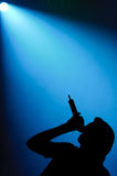 Male Singer Under Spotlight Stock Image