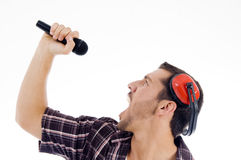 Male singing loudly on microphone. On an isolated white background Royalty Free Stock Photography