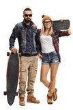 Male skater and female skater. Full length portrait of male skater with a longboard and a female skater with a skateboard isolated on white background Stock Images