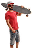 Male skater holding a longboard. Vertical shot of a male skater holding a longboard and looking at the camera isolated on white background Royalty Free Stock Images