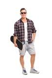 Male skater holding a skateboard Royalty Free Stock Photo
