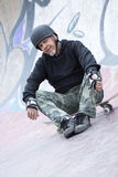 Male skater sitting down Royalty Free Stock Photography