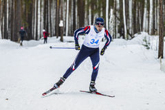Male skier athlete men in winter woods free style. Kyshtym, Russia -  March 26, 2016: male skier athlete men in winter woods free style during Championship on Stock Photography