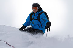 Male skier backcountry. Male skier is skiing backcountry Stock Image