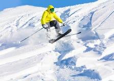 Male skier launching of mogul hitting the slopes. Male skier launching of mogul jumping and hitting the slopes Stock Image