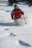 Male skier in powder. Male skier skiing down an almost untouched slope Royalty Free Stock Photos