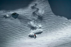 Male skier riding down the hill. Amazing view of a skier riding down the piste Stock Photos