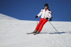Male skier. Seasoned male skier carving down a snowcovered ski slope Royalty Free Stock Image