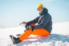 Male skier sitting on snow relaxing Royalty Free Stock Photo