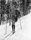 Male skier skiing downhill. (All persons depicted are no longer living and no estate exists. Supplier grants that there will be no model release issues Stock Photo