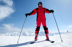 Male skier at Solden ski resort. Male skier in red suit shoot with wide angle lens from low viewpoint Royalty Free Stock Photography