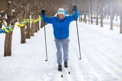 Male is skiing on the competition. Man rides cross-country skiing in winter Park Stock Photography