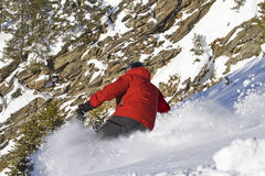 Male skiing in sloping position. Man is skiing back country Stock Photography