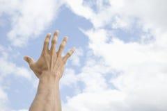 male sky för fördjupad hand in mot Fotografering för Bildbyråer