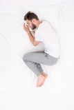 Male sleeping Foetus pose. Concept of sleeping poses. Male quiet Foetus pose Royalty Free Stock Image