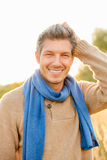 Male. Smiling cute male in autumn fall season Royalty Free Stock Photo