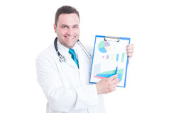 Male smiling doctor showing statistics on clipboard. Male smiling doctor or medic showing statistics on clipboard isolated on white background Royalty Free Stock Photos