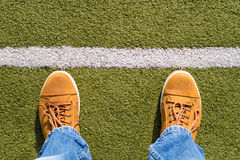 Male sneakers on the artificial grass Royalty Free Stock Photography
