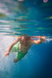 Male snorkeler divingin the sea. Young male snorkeler divingin the sea Royalty Free Stock Photo