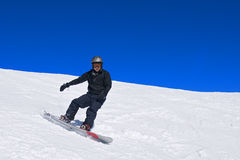Male snowboarder stock photography