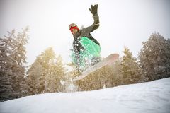 Male snowboarder in action. On snowboard Royalty Free Stock Photo