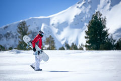 Male snowboarder against panoramic winter Royalty Free Stock Images