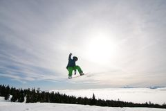 Male Snowboarder Catches Big Air. Stock Images